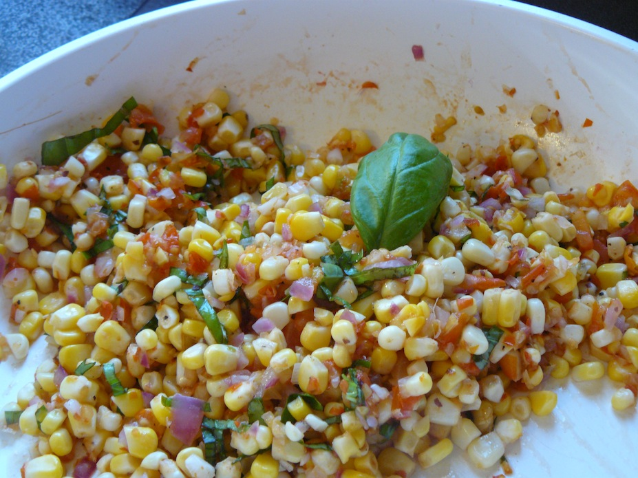 Corn salad with basil, cherry tomatoes and red onion